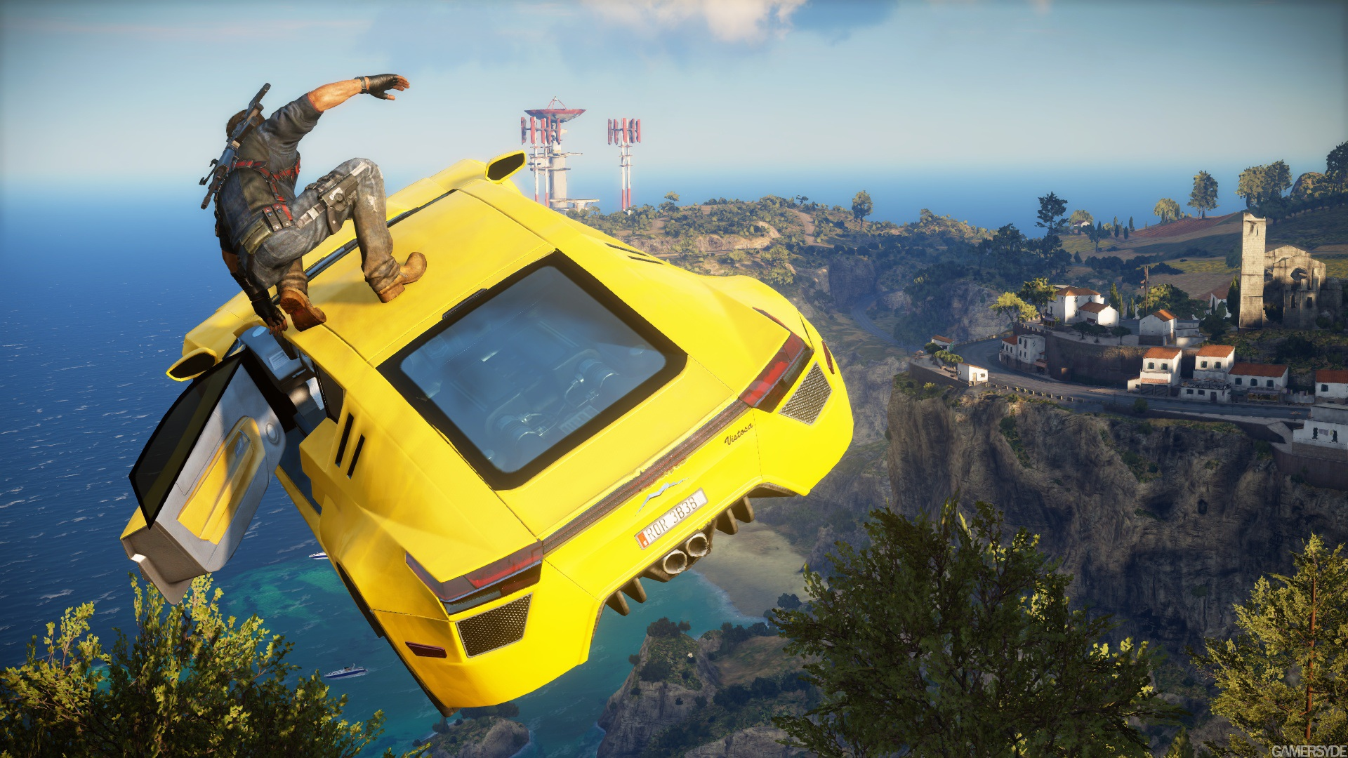 Rico on top of car in mid-air