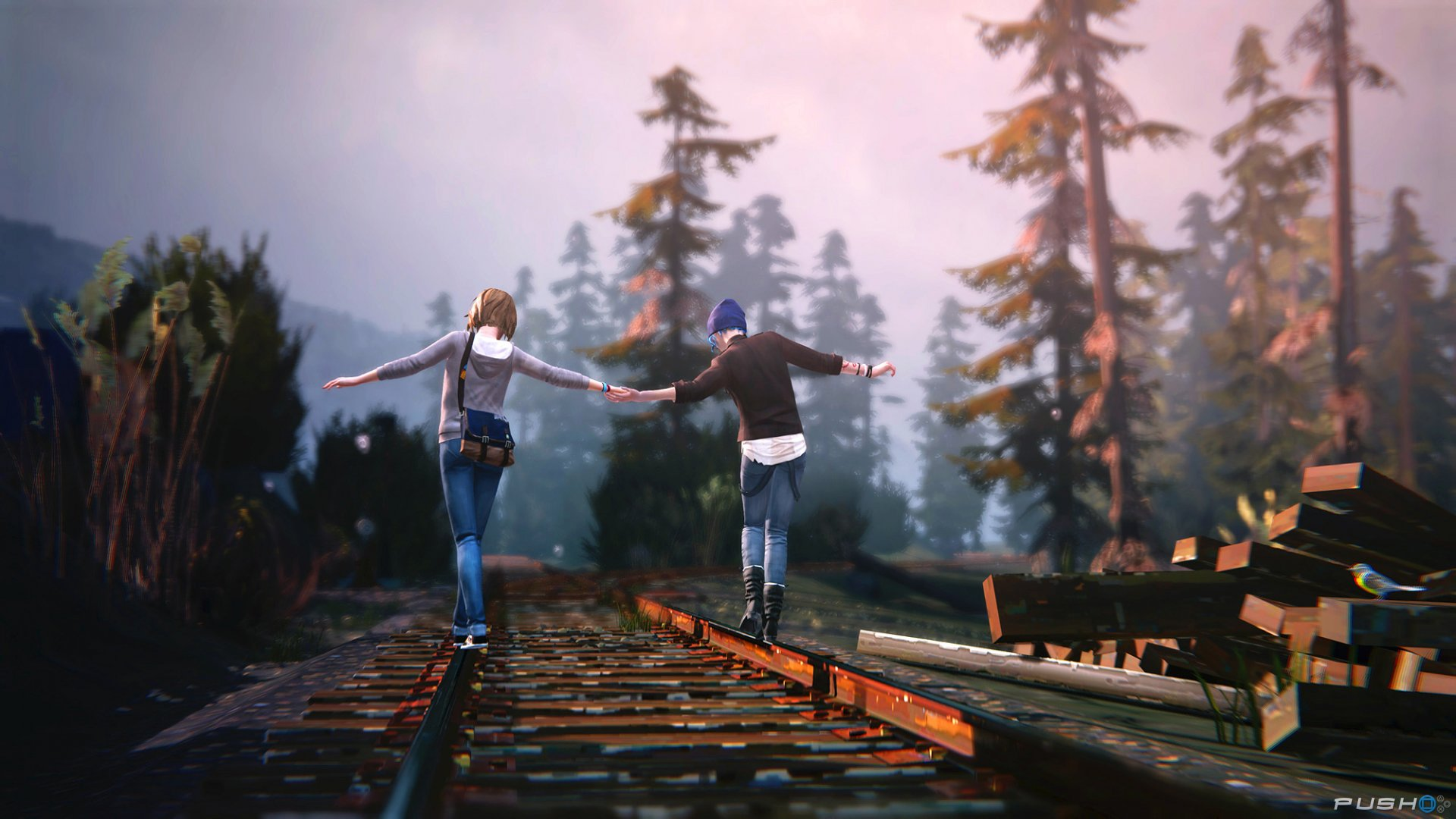 Max and Chloe walking on train tracks