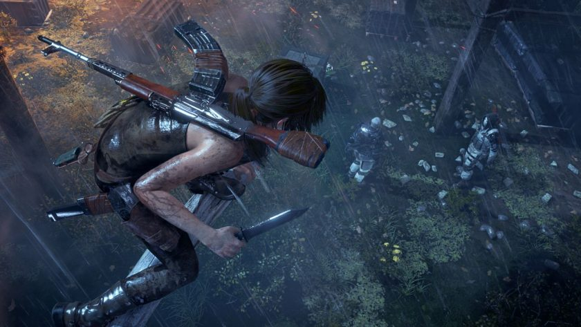 Lara Croft hiding on a branch with a knife