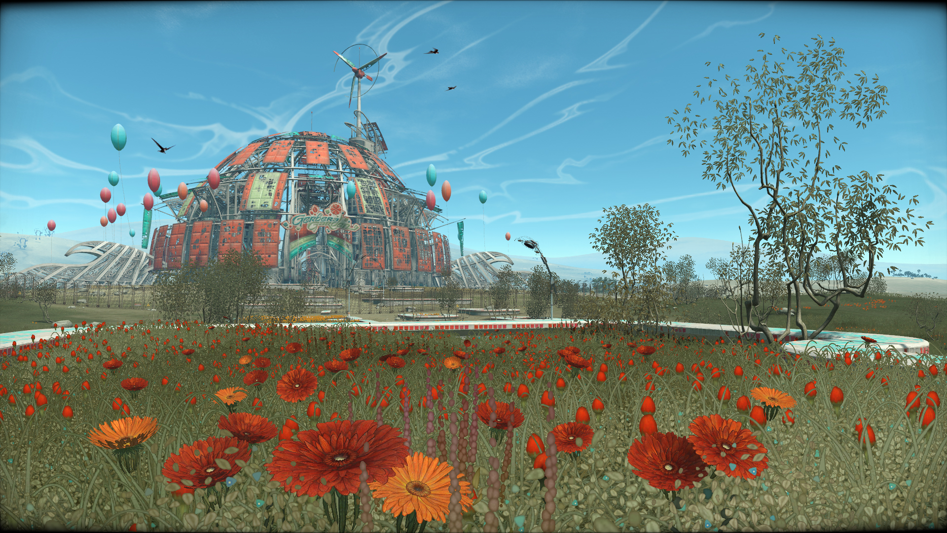 Flowerbed with a large ruined dome in the background