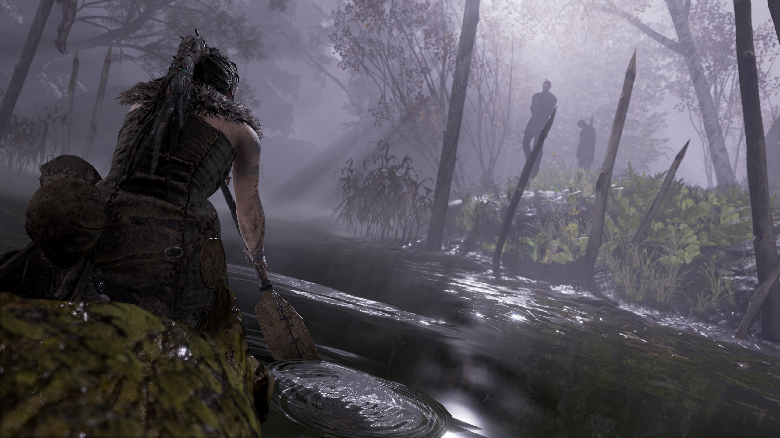 Senua paddling in a log in the woods
